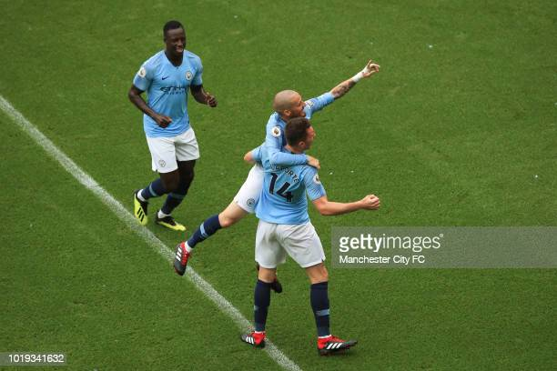 David Silva of Manchester City celebrates scoring the 4th goal with Aymeric Laporte and Benjamin Mendy of Manchester City during the Premier League...