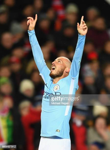 David Silva of Manchester City celebrates scoring the first Manchester City goal during the Premier League match between Manchester United and...
