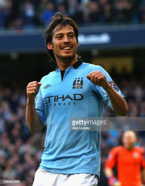David Silva of Manchester City celebrates scoring the opening goal during the Barclays Premier League match between Manchester City and Aston Villa...