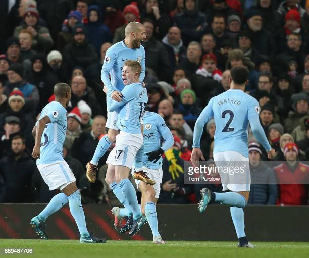 David Silva of Manchester City celebrates scoring their first goal during the Premier League match between Manchester United and Manchester City at...
