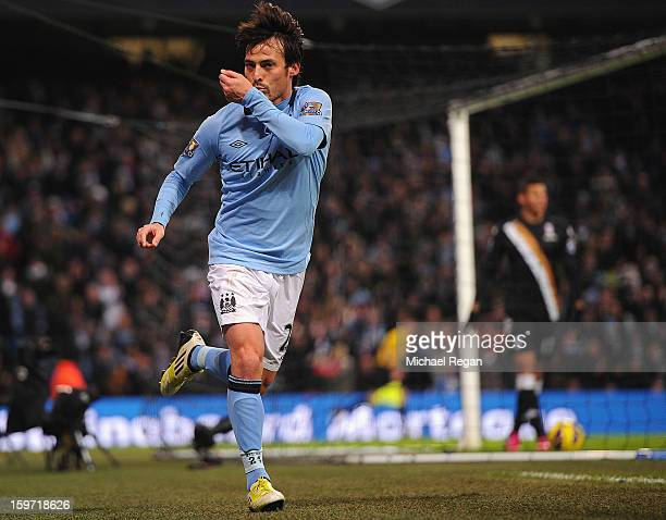 David Silva of Manchester City celebrates scoring to make it 20 during the Barlcays Premier League match between Manchester City and Fulham at the...