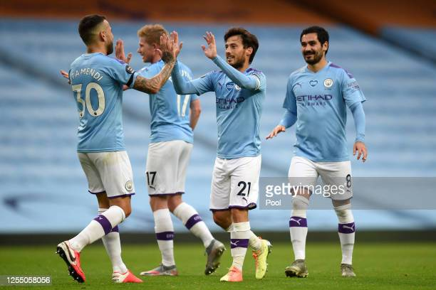 David Silva of Manchester City celebrates with his team after he scores his sides fourth goal from a free kick during the Premier League match...