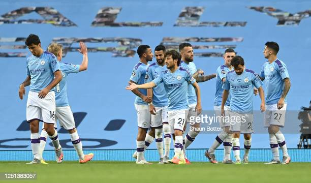 David Silva of Manchester City celebrates with his team mates after scoring his teams fourth goal during the Premier League match between Manchester...
