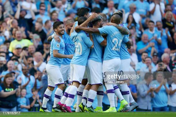 David Silva of Manchester City celebrates with his team mates as he scores his team's first goal during the Premier League match between Manchester...