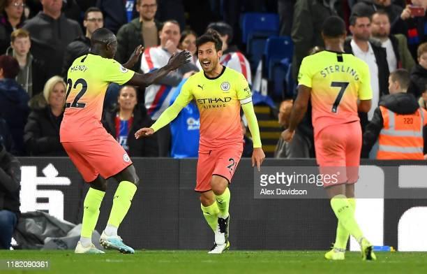 David Silva of Manchester City celebrates with his teammates Benjamin Mendy and Raheem Sterling of Manchester City after scoring his teams second...