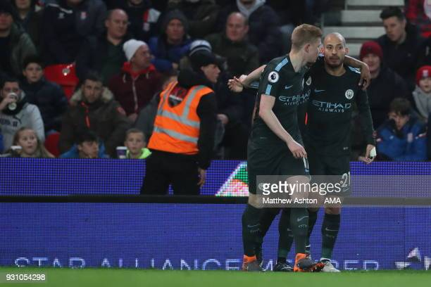 David Silva of Manchester City celebrates with Kevin De Bruyne of Manchester City after scoring a goal to make it 10 during the Premier League match...