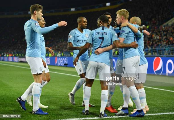 David Silva of Manchester City celebrates with teammates after scoring his team's first goal during the Group F match of the UEFA Champions League...