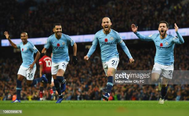 David Silva of Manchester City celebrates with teammates Fernandinho Riyad Mahrez and Bernardo Silva after scoring his team's first goal during the...