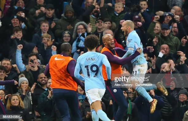 David Silva of Manchester City celebrates with Vincent Kompany after scoring the winning goal during the Premier League match between Manchester City...