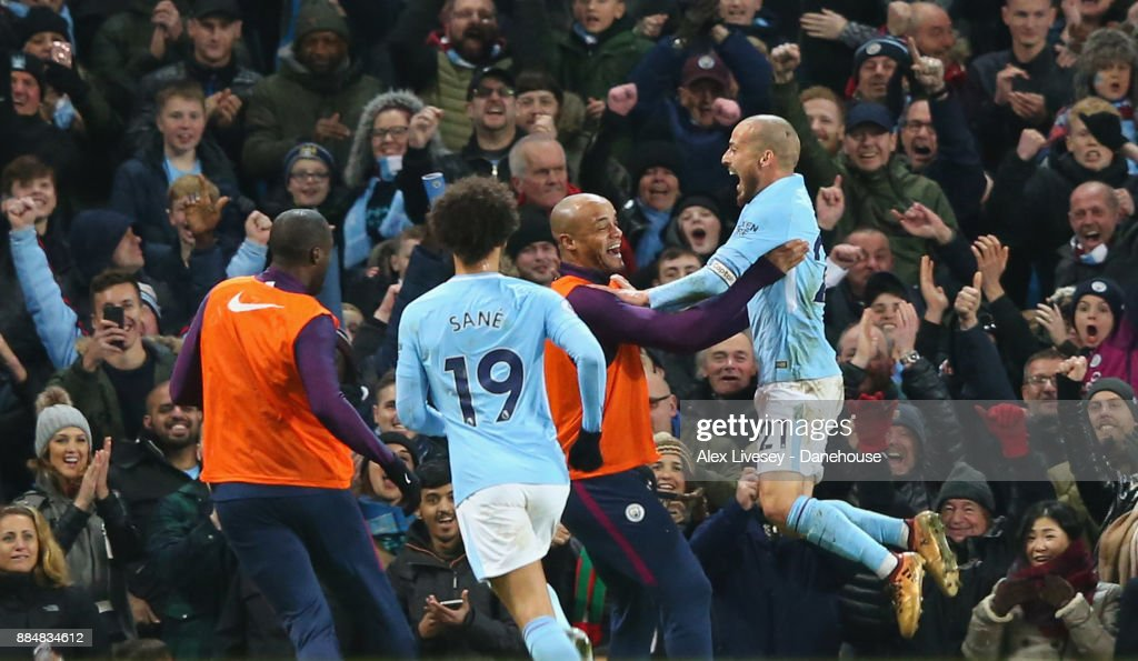 https://media.gettyimages.com/photos/david-silva-of-manchester-city-celebrates-with-vincent-kompany-after-picture-id884834612