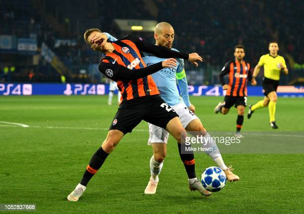 David Silva of Manchester City challenges for the ball with Mykola Matviyenko of Shakhtar Donetsk during the Group F match of the UEFA Champions...