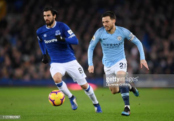 David Silva of Manchester City chases down Andre Gomes of Everton during the Premier League match between Everton FC and Manchester City at Goodison...