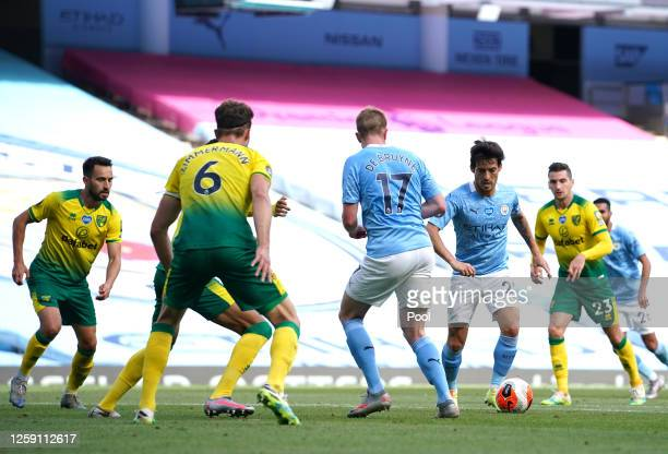 David Silva of Manchester City controls the ball during the Premier League match between Manchester City and Norwich City at Etihad Stadium on July...