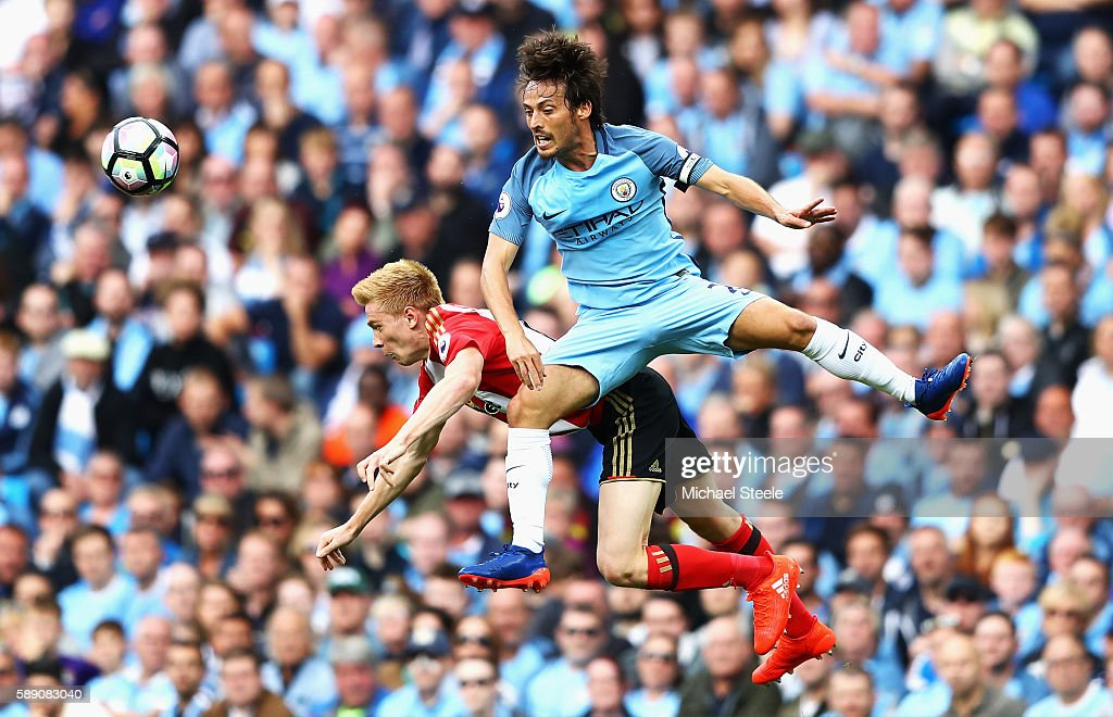 David Silva of Manchester City fouls Duncan Watmore of Sunderland during the Premier League match between Manchester City and Sunderland at Etihad Stadium on August 13, 2016 in Manchester, England.