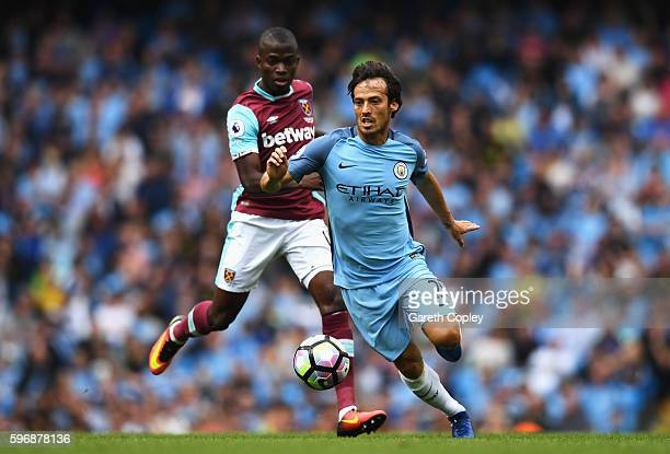David Silva of Manchester City goes past Enner Valencia of West Ham United during the Premier League match between Manchester City and West Ham...