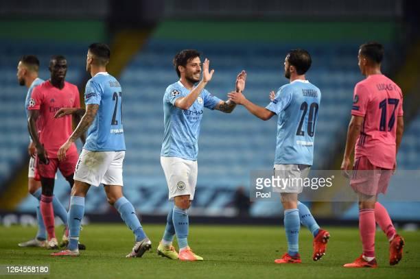 David Silva of Manchester City greets Bernardo Silva of Manchester City following the UEFA Champions League round of 16 second leg match between...