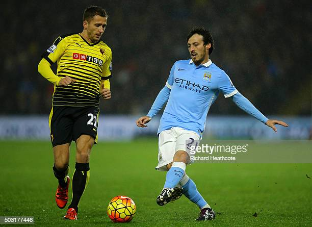 David Silva of Manchester City holds off Almen Abdi of Watford during the Barclays Premier League match between Watford and Manchester City at...