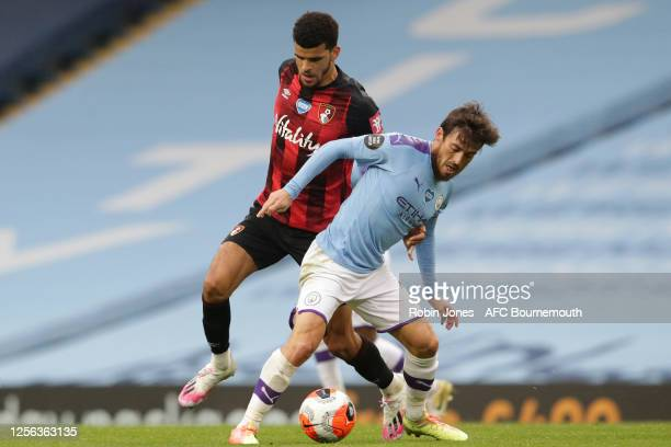 David Silva of Manchester City holds off Dominic Solanke of Bournemouth during the Premier League match between Manchester City and AFC Bournemouth...