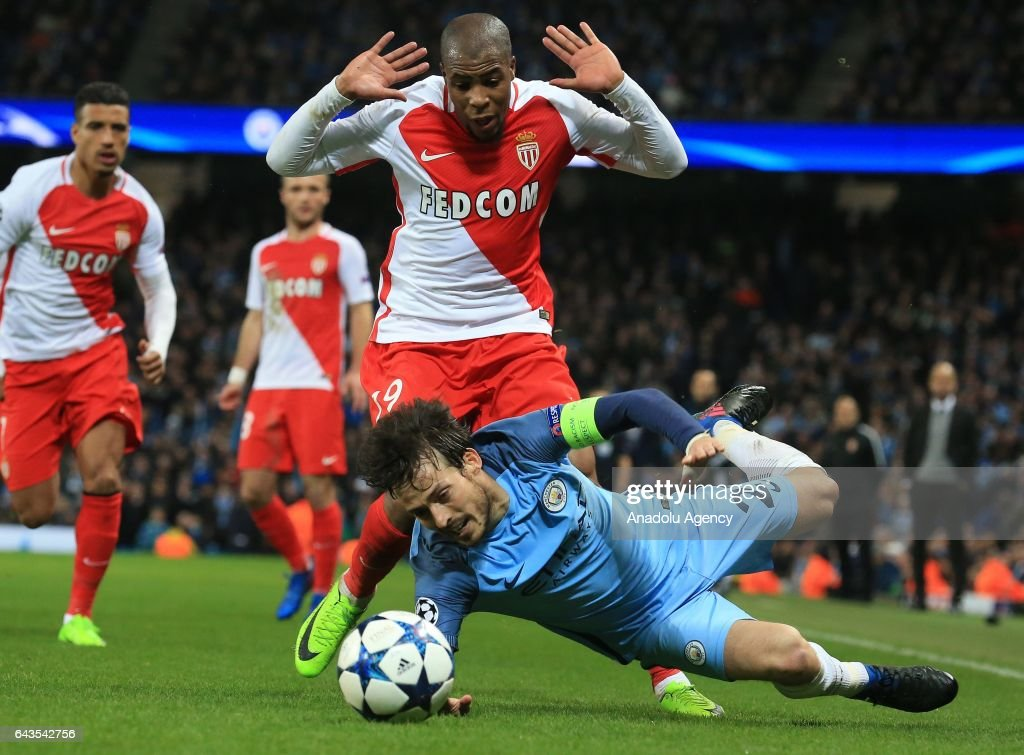 David Silva of Manchester City in action against Djibril Sidibe (Rear) of AS Monaco during the UEFA Champions League Round of 16 soccer match between Manchester City FC and AS Monaco at the Etihad stadium in Manchester, United Kingdom on February 21, 2017.