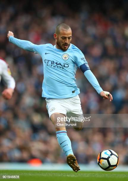 David Silva of Manchester City in action during The Emirates FA Cup Third Round match between Manchester City and Burnley at Etihad Stadium on...