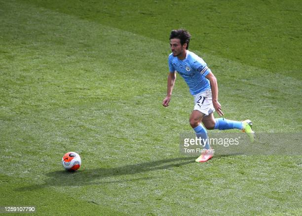David Silva of Manchester City in action during the Premier League match between Manchester City and Norwich City at Etihad Stadium on July 26, 2020...