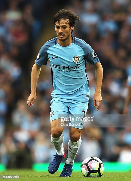 David Silva of Manchester City in action during the Premier League match between Manchester City and West Ham United at Etihad Stadium on August 28...