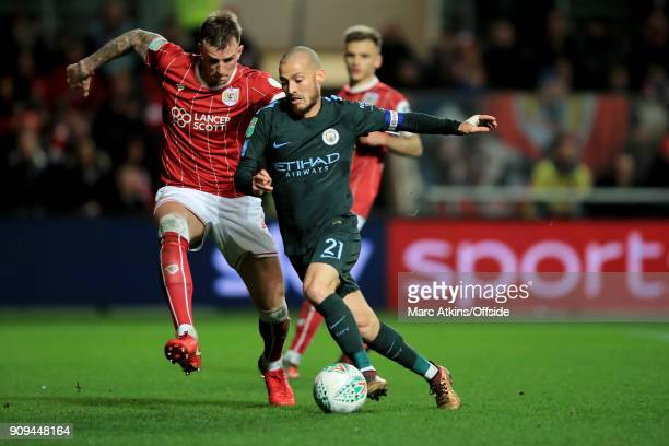 David Silva of Manchester City in action with Aden Flint of Bristol City during the Carabao Cup SemiFinal 2nd leg match between Bristol City and...