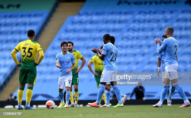 David Silva of Manchester City is applauded by his teammates as he is substituted on his final appearance for Manchester City during the Premier...
