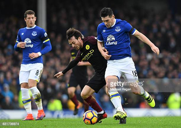 David Silva of Manchester City is challenged by Gareth Barry of Everton during the Premier League match between Everton and Manchester City at...