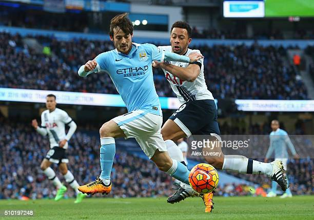 David Silva of Manchester City is challenged by Mousa Dembele of Tottenham Hotspur during the Barclays Premier League match between Manchester City...