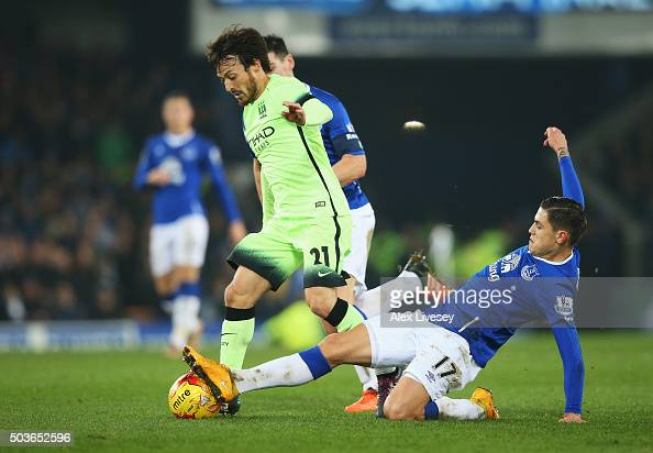 David Silva Of Manchester City Is Challenged By Muhamed