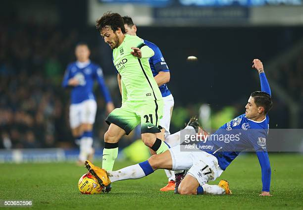 David Silva of Manchester City is challenged by Muhamed Besic of Everton during the Capital One Cup Semi Final First Leg match between Everton and...