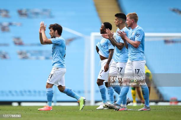 David Silva of Manchester City is congratulated by his team mates as he is substituted off making his final league appearance for the club during the...