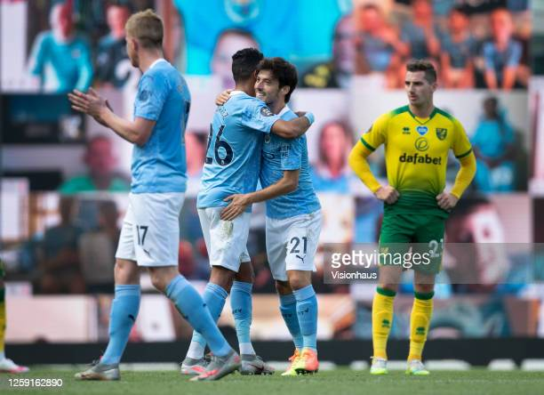 David Silva of Manchester City is congratulated by team mate Riyad Mahrez as he is substituted during his last game for Manchester City during the...