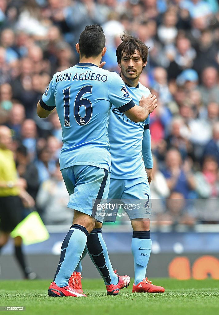 David Silva (R) of Manchester City is congratulated by teammate Sergio Aguero of Manchester City after scoring his team's sixth goal during the Barclays Premier League match between Manchester City and Queens Park Rangers at the Etihad Stadium on May 10, 2015 in Manchester, England.