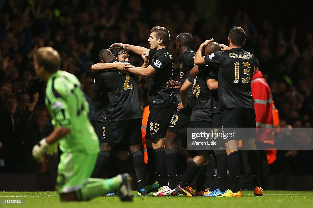 David Silva of Manchester City is congratulated by teammates after scoring his team's third goal during the Barclays Premier League match between West Ham United and Manchester City at Boleyn Ground on October 19, 2013 in London, England.