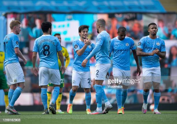 David Silva of Manchester City is congratulated by teammates as he is substituted during his last game for Manchester City during the Premier League...