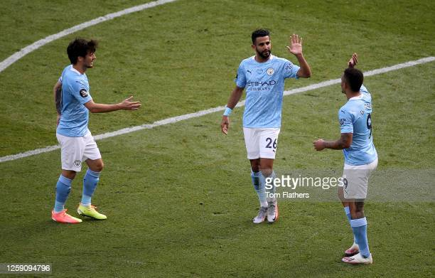 David Silva of Manchester City is congratulated by teammates as he comes off during his last game for Manchester City during the Premier League match...