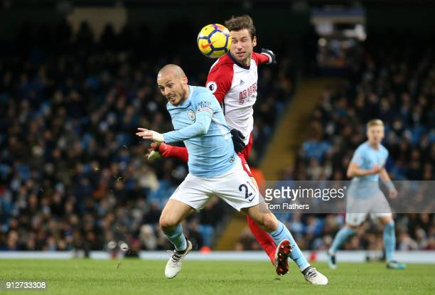 David Silva of Manchester City is fouled by Grzegorz Krychowiak of West Bromwich Albion during the Premier League match between Manchester City and...