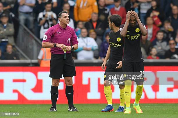 David Silva of Manchester City is shown a yellow card during the Premier League match between Swansea City and Manchester City at the Liberty Stadium...