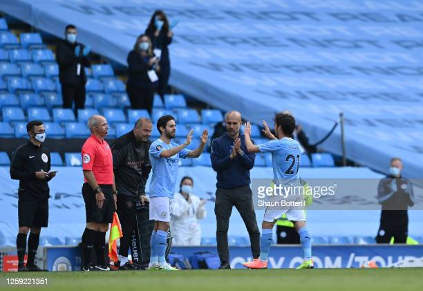 David Silva of Manchester City is substituted for Bernardo Silva as manager Pep Guardiola applauds on his final performance for Manchester City...