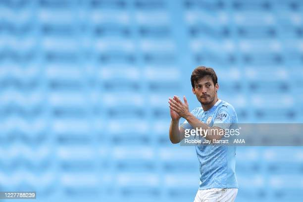 David Silva of Manchester City is substituted off as he makes his last league appearance for the club during the Premier League match between...