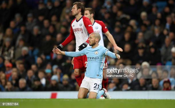 David Silva of Manchester City is tackled by Grzegorz Krychowiak of West Bromwich Albion during the Premier League match between Manchester City and...