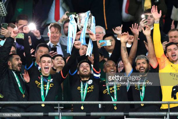 David Silva of Manchester City lifts The Carabao Cup trophy following his side's victory during the Carabao Cup Final between Aston Villa and...