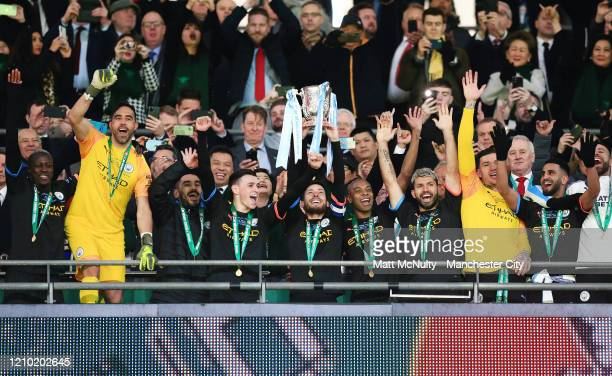 David Silva of Manchester City lifts the Carabao Cup trophy with teammates during the Carabao Cup Final between Aston Villa and Manchester City at...