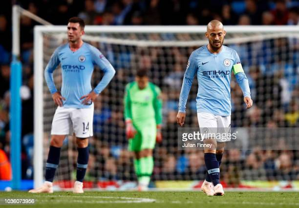 David Silva of Manchester City looks dejected after conceding a second goal during the Group F match of the UEFA Champions League between Manchester...