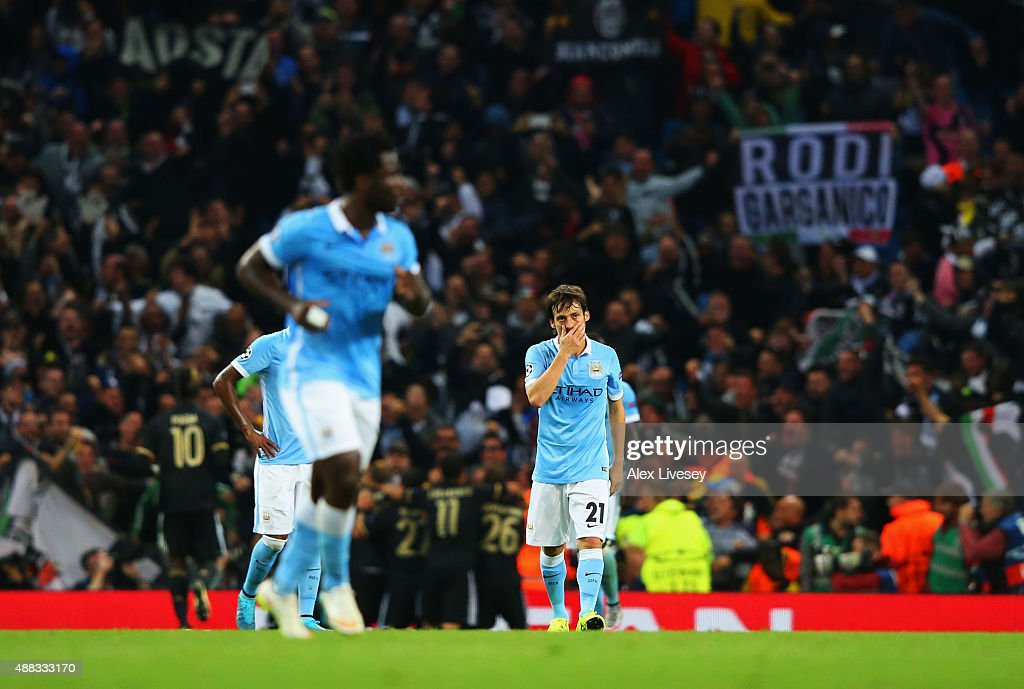 David Silva of Manchester City (21) looks dejected as Mario Mandzukic of Juventus (not pictured) scores their first and euqlaising goal during the UEFA Champions League Group D match between Manchester City FC and Juventus at the Etihad Stadium on September 15, 2015 in Manchester, United Kingdom.