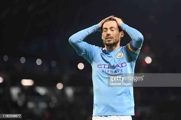 David Silva of Manchester City looks dejected during the Premier League match between Manchester City and Manchester United at Etihad Stadium on...
