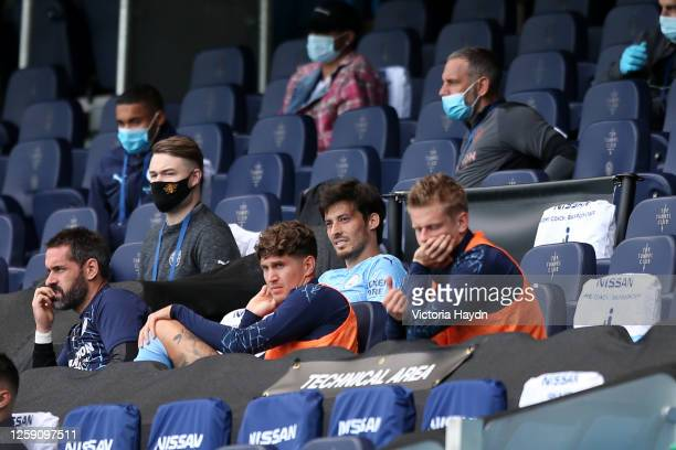 David Silva of Manchester City looks on from the substitutes bench during the Premier League match between Manchester City and Norwich City at Etihad...