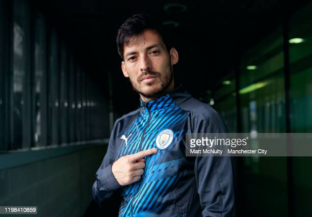 David Silva of Manchester City models the new Puma Manchester City Stadium Jacket at Manchester City Football Academy on November 27, 2019 in...